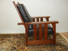 GUSTAV STICKLEY #334 MORRIS CHAIR  Slatted, corbeled smaller Morris chair. Over coat on original finish. Releathered with quality leather correct to piece.