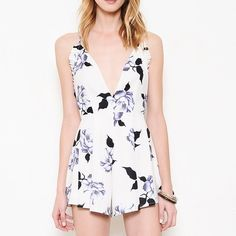 Deep Plunge White Romper Purple floral deep plunge pleated romper. Only available in this color. Junior sizing. Runs small at the waist. Brand new. Absolutely NO TRADES, don't ask. PRICE FIRM. Bare Anthology Pants Jumpsuits & Rompers