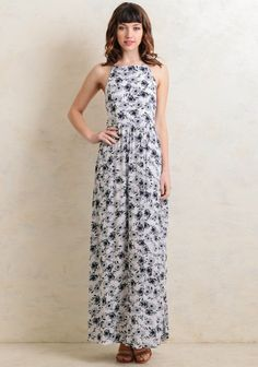 This ethereal maxi dress is crafted in an ivory tone with a romantic navy and gray floral print. The halter neckline is accented by dual adjustable straps and ruching at the back for a perfect fi...