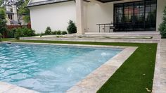 Swimming pool with Silver Travertine, Auqa Blue Pebble Sheen, artificial turf Pool Coping, Swimming Pool Kits, Travertine Pavers, Pool Colors, Family Pool, Fake Grass, Astro Turf, Dream Pools, Pool Decks