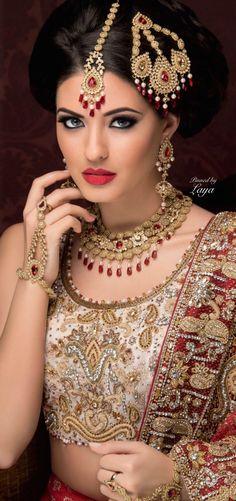 LAYA; beautiful 3 pronged gold jhoomar to match her lehenga. #IndianWedding, #SouthAsianWedding, #ShaadiShop