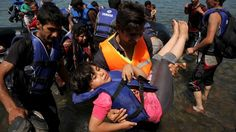 Afghan immigrants arrive in a dinghy on the Greek island of Lesbos after crossing a part of the Aegean Sea on August 6, 15.  The United Nations refugee agency estimates that Greece has received more than 107,000 refugees and migrants this year, more than double its 43,500 intake in 2014.