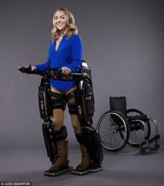 Sophie Morgan in the robotic exoskeleton Rex, with her wheelchair in the background