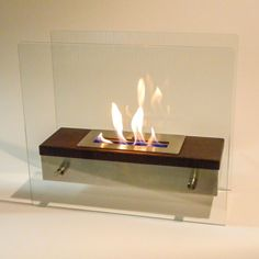 "Nu-Flame Foreste Ardore - Table Top  Ethanol Fireplace (NF-F2FOA) A large capacity stainless steel burner is capped with a realistic dark walnut wood finish cover drawing attention to the dancing flames. #29""-and-Less #Ethanol #Free-Standing. Modern Blaze"