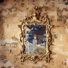 Chinese mirror painting in a Rococo frame hung on a wall covered with Chinese wallpaper, at Saltram, Devon. ©NTPL/Andreas von Einsiedel