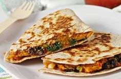 Sweet Potato, Black Bean & Kale Quesadilla (I would use goat cheese instead of cheddar)...YUM! All these (organic) ingredients are available at Trader Joe's! Including the Organic Whole Wheat Tortillas! Easy as pie! :)