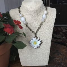 Look at this beautiful daisy necklace! You can buy it for only $25.00 at my shop! Put the URL in your browser or just tap VISIT to learn more about this piece. https://www.etsy.com/listing/547594078/boho-necklace-long-boho-necklace-tribal-boho-necklace-pagan-necklace-festival-necklace-amulet-necklace-talisman-necklace-fantasy-necklace $30.00