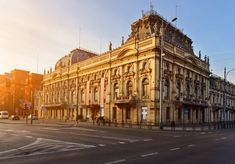 streetside view of Poznanskis Palace in Łódź at sunset with street in front Weekend Trips, Day Trips, Poland Travel, Central Station, Urban Life, Travel Planner, Buy Tickets, Warsaw, Public Transport