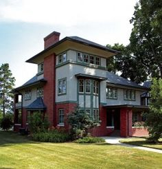 Restoring the exterior of this Prairie house involved chemically stripping epoxy-based paint from the bricks and stucco. Photo: Scott Van Dyke