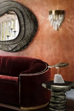 This living room has the KUMI Round Mirror, the NAICCA Wall Light, LATZA Side Table, CALLA Table Light, WALES Sofa and the Snake rug.