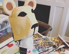 """""""She had managed to procure a hat shaped like a life-sized lion's head, which was perched precariously on her head."""" See post 1 with the . Ropa Burning Man, Lion Hat, Christmas Clearance, Harry Potter Birthday, Gold Embroidery, Black Acrylics, White Clay, Felt Fabric, Black Felt"""