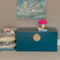 Beautiful turquoise lacquered wood storage trunk with brass handles and traditional Chinese lock and pin. Use it for linen storage, a toy box or for decoration at the foot of a bed. Chinese lacquered wooden trunks also make attractive small wooden coffee tables. Also in Turquoise.