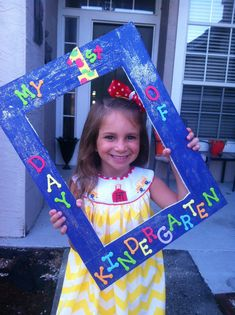First day of kindergarten sign idea--(my prior one looked a bit too much like a mug shot)....I'll try this!