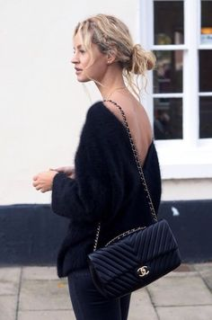 Pretty Street Style – black fluffy sweater, chanel bag and messy bun.