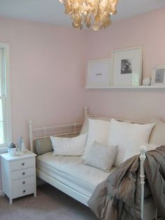 I would love to know the color of this pink paint. The perfect pink eluded us for baby's room. And look how amazing it looks with pewter and white decor.