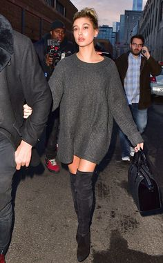Hailey Baldwin from Stars at New York Fashion Week Fall 2015  Also supporting Kanye West's Adidas collaboration, the model attends the show in a sweater dress and thigh-high boots.