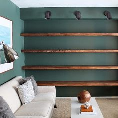 Solid Wood Wall-to-Wall Shelves Check out this idea for shelving! (via Chris Loves Julia)Check out this idea for shelving! (via Chris Loves Julia) Kitchen Wall Shelves, Floating Wall Shelves, Wall Shelving, Wall Shelves For Books, Bedroom Wall Shelves, Diy Bookshelf Wall, Basement Shelving, Wooden Wall Shelves, Fireplace Shelves
