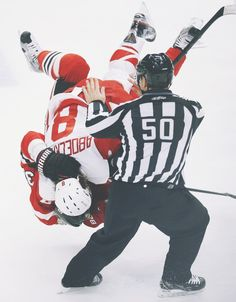 What is this? Abby Is Tackling A Colorado Player Not Sure But I Think it Was Peter Forsberg