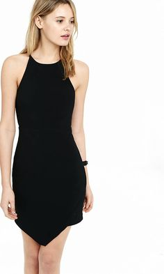 There is flattering architecture in every style detail of this showstopping little black dress. The high neck with short spaghetti straps and the asymmetrical hem add up to one stunning look.