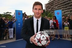 Leo Messi poses outside the Grimaldi Forum with the adidas official match ball…