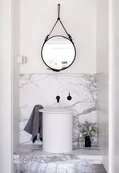 via Design Files - Amazing bathroom with black leather captain's mirror hanging over white vessel sink with wall-mount oil-rubbed bronze faucet kit. Modern floating bathroom vanity with marble countertop and marble slab backsplash. White Bathroom, Bathroom Interior, Modern Bathroom, Small Bathroom, Bathroom Marble, Bathroom Ideas, Bathroom Basin, Design Bathroom, Bathroom Splashback