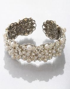 Cierra cuff by Cierra cuff // More from Cierra cuff: http://www.theknot.com/gallery/bridal-accessories/meg-jewelry