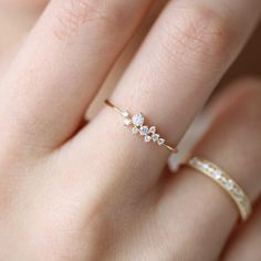 This delicate, sparkly stacking ring will melt your heart. Nine 9 glowing top grade cz stones are prong set on an 18K yellow gold vermeil band. 18K yellow gold vermeilSterling silver base5A grade 9 simulated diamondsProng set stones.7mm band thickness