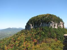 We can't decide which is prettier — the early autumn foliage as it begins to change colors, or this interesting rock formation atop Pilot Mountain.  - GoodHousekeeping.com
