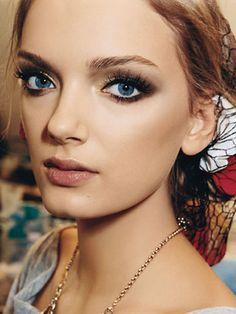 Eyes: champagne shimmer, brown liner, false lashes