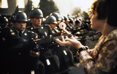 Marc Riboud  USA. Washington DC. 1967. An American young girl, Jan Rose KASMIR, confronts the American National Guard outside the Pentagon during the 1967 anti-Vietnam march. This march helped to turn public opinion against the US war in Vietnam.