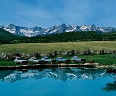 Love the mountain feel of this pool.  Natural rock coping and split rail fence make it for me.