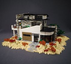 The incredibly talented Sarah Beyers shares an amazing LEGO home worthy of an ocean view. Brick Building, Lego Building, Modern Mansion, Modern Houses, Lego Modular, Lego Room, Cool Lego Creations, Lego House, Lego Projects