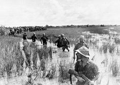 A French non-commissioned officer leads an Algerian unit of the French colonial forces through a swamp in the countryside of Indochina, during war operations against the Communist Viet Minh, on August Non Commissioned Officer, First Indochina War, World Conflicts, French Foreign Legion, French Colonial, French History, Indochine, France, Vietnam War