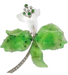 """A brilliant and gemstone brooch """"Orchid"""" white gold 750, inscribed: Sikan Rom, brilliants, total weight ca.1,20 ct Tsavorite, cut rock crystal and Nephrite, 37,7 g,"""