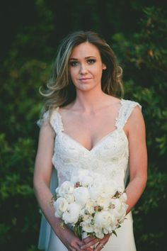 This beautiful bride is wearing a stunning gown by  / Photography by
