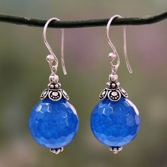 Globes of deep blue chalcedony reveal subtle honeycomb facets in handcrafted earrings. Narayani designs the earrings of sterling silver to showcase the lovely gems.