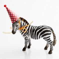 You can't go wrong with a zoo theme for your baby's first-birthday party.                 Plastic Parade Set the scene with toy animals wearing party hats -- create a conga line of critters. Cut half circles and roll them into cones, then trim if necessary. Glue a pom-pom to the top and 2 thin ribbons inside for a tie.                  Wild Kingdom Cake For a dessert that will really impress the guests, visit parents.com/animal-cake.                  Take-Home Treat For favors, decorate…