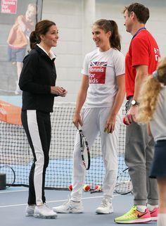 Kate Middleton Photos - Catherine, Duchess of Cambridge, speaks with British player Johanna Konta (C) as she prepares to take part in a Tennis for Kids session during a visit at the Lawn Tennis Association (LTA) at the National Tennis Centre on October 31, 2017 in southwest London, England. The Duchess of Cambridge, who became Patron of the LTA in December 2016, visited the LTA, the national governing body of tennis in Great Britain, where she was briefed on the organisations latest…