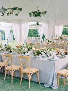 Tented reception in white and pale blue with draped ceilings, crystal chandeliers and greenery vines ~ http://www.stylemepretty.com/2016/01/14/thailand-destination-wedding-part-ii/