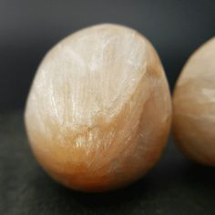 This listing is for 1 large tumbled Stilbite crystal. This chunky peach crystal has beautiful chatoyancy and is a considered a heart and crown chakra crystal used by energy workers, reiki practioners and crystal healers. Dimensions at the widest point:  1.1 - 1.18 28-30mm 16-20g  Origin: India  Mohs Hardness: 3.5 - 4  Your crystal will come carefully wrapped and ready to love!  ♥ Like and Follow my Facebook and Instagram pages for updates, giveaways and discounts. ➠…