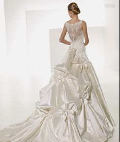 Gorgeous.  I think I would take off the bows, but otherwise I think this is very pretty!
