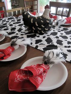 Cow print table runner and feather napkin holders - pure country!