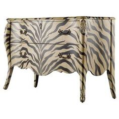 "Two-drawer scalloped bombe chest with an exotic zebra-print motif.Product: ChestConstruction Material: Hardwood solids and veneersColor: Black and ivoryFeatures:  Scalloped bottomTwo drawersZebra-print design Dimensions: 35.5"" H x 56.5"" W x 21"" D"