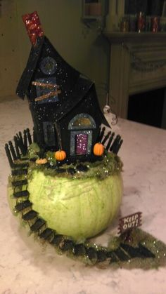 Halloween un carved pumpkin- haunted house made out of card stock and glittered. Add cute details like boarded up windows, picket fence, etc and makes a one of a kind pumpkin.