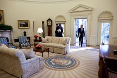President Barack Obama walks into the Oval Office at the White House for his first full day in office on Jan. 21, 2009.