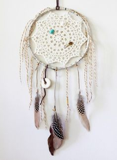 dreamcatcher, yet another twist on the dreamcatcher using a crochet doily in the center instead of the traditional blanket stitch.
