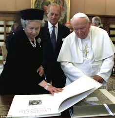 The Queen Elizabeth and Prince Philip show Pope John Paul II a book with 50 reproductions from Canaletto prints at the end of their private audience in the Vatican in 2000