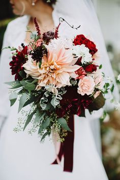 In love with this giant peach dahlia surrounded by crimson and red blooms ~ we :heart: this! http://moncheribridals.com