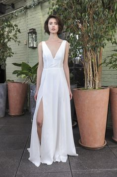 Clean and simple deep v-neck wedding dress with slit by @sarahseven   Bridal Market Fall 2016