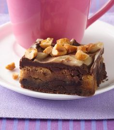 """Packed with two layers of cookies—peanut butter and double chocolate chunk—this recipe seriously raises the bar when it comes to easy desserts. Betty member Sam28 raves, """"Wow! I think I just took care of my chocolate craving for the week! These were outrageously good!"""""""